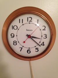 round white and brown analog wall clock