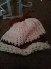 white and brown knit cap