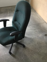 green padded rolling armchair London, N5W 6G6