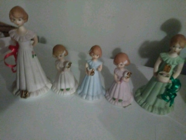 five assorted-color dressed women figurines