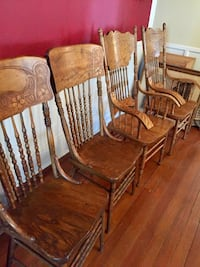 These are beautiful Solid Oak Dining or Kitchen Chairs. Lovely graceful carvings on each and beautiful oak design throughout  2 Chairs have Arms and 2 Chairs are armless. Heads of table usually use Arms   Berwyn Heights, 20740