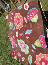 brown, pink, and teal floral area rug