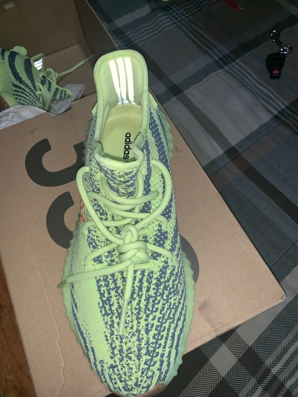 designer fashion b019d 8ecf9 Pair of lime green adidas yeezy boost 350 in box