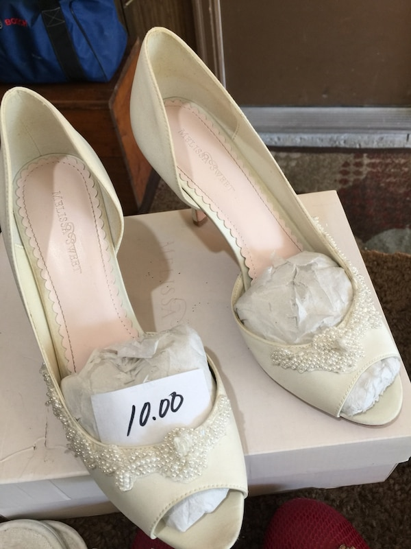 56c6dd4db1e3 Used women s pair of white peep toe heels. Purchased from David s Bridal.  Size 10. Good condition