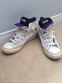 pair of white Converse All Star high top sneakers