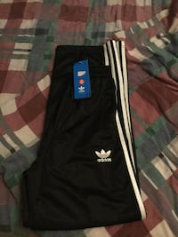 Adidas black with white stripes, brand new with tags. Women's medium