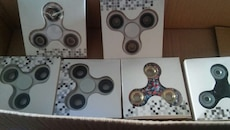 six white, black and beige fidget spinner in boxes