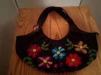 black blue and red floral handbag