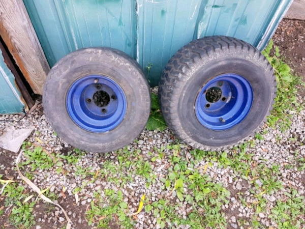 two black bullet hole car wheels with tires