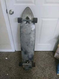 gray and black skateboard deck Katy Freeway