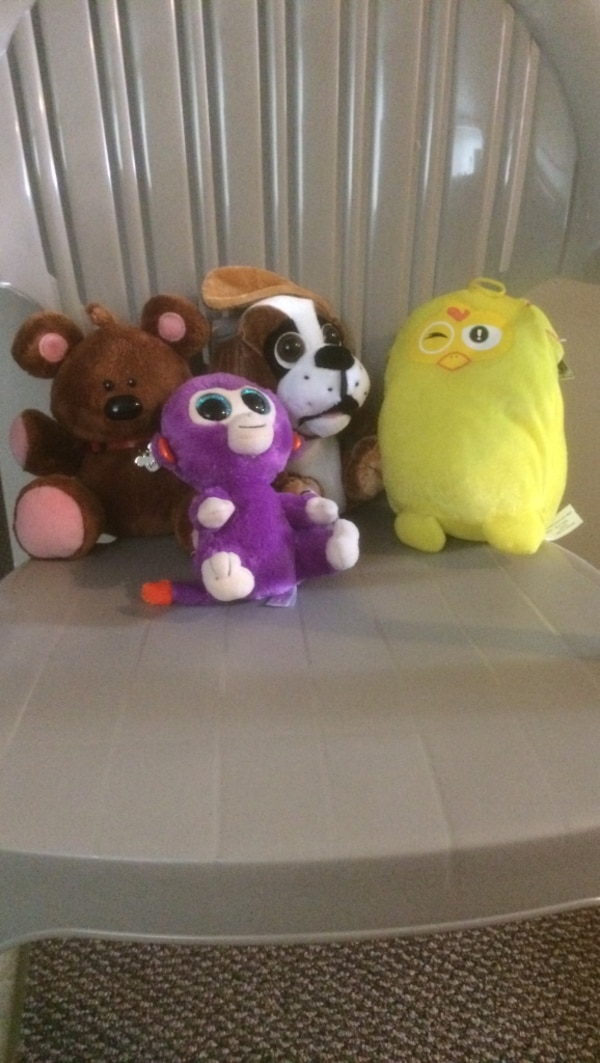Four animal plush toys brand new with tag attached