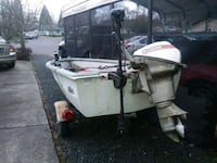 white outboard boat