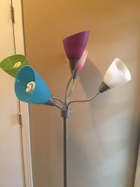 gray floor lamp with five task lights