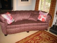 brown fabric 2-seat sofa with throw pillows Greenville