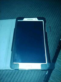 Samsung galaxy A tab 4. Barely used. Comes with leather case Reston, 20190