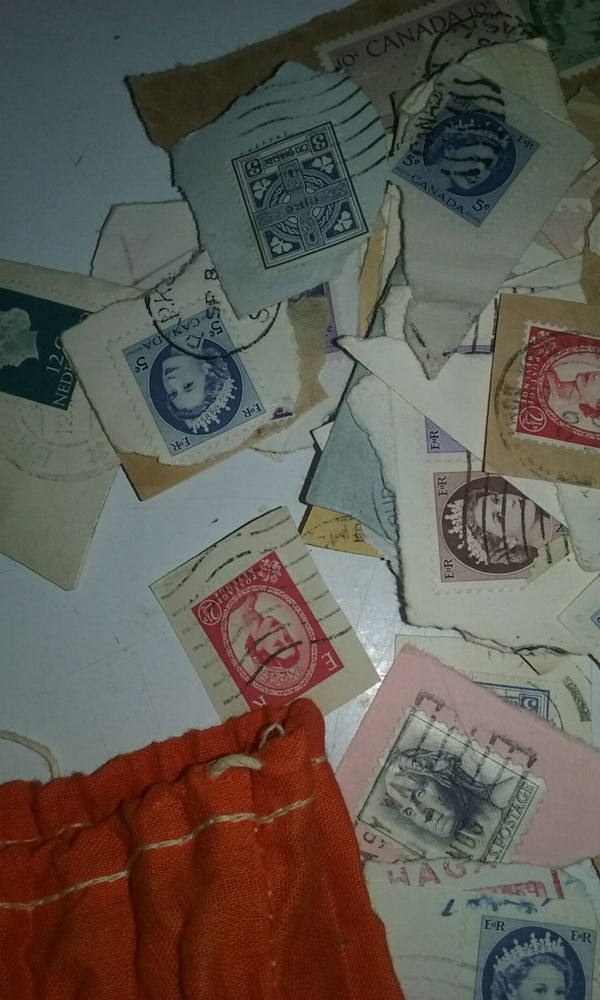 Two bags full of foreign stamps 3010534b-37fd-4eaa-9446-b624c533f269