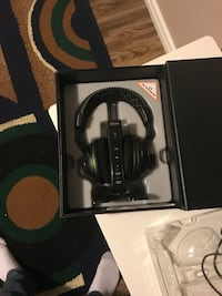 black and green cordless headphones with charger and box Edmonton, T5L 1P5