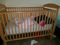 baby's brown wooden crib Tampa, 33612