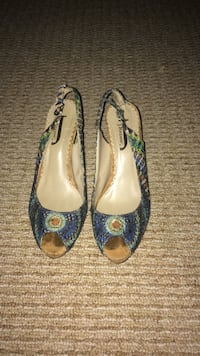 pair of blue-and-brown leather pumps
