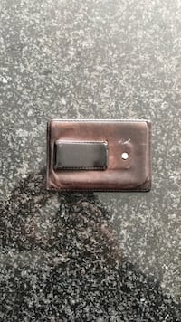 Brown leather coach money clip