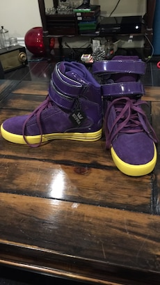 purple-and-yellow Supra high top sneakers