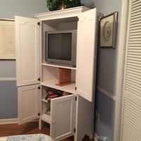 white wooden TV hutch with flat screen television Lafayette, 70508