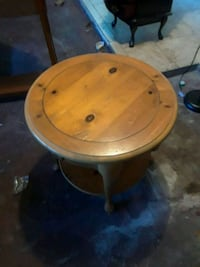 round brown wooden pedestal table Port Richey, 34668