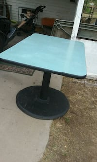 rectangular black wooden table with gray metal base