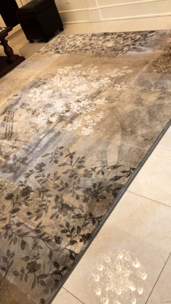 Brown and gray floral carpet 9 by 12