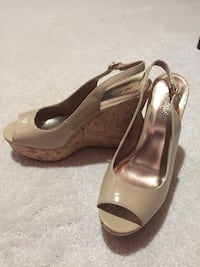 Pair of brown leather peep toe platform pumps Calgary, T3B 5S2