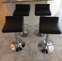 Four Black Leather padded bar stools with Chrome adjustable bottom Penfield, 14580