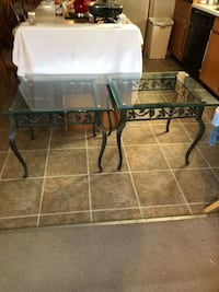Price reduced !! Indoor/ outdoor!! Wrought iron glass topped TWIN end tables in excellent condition !! 23x28x25 Lafayette, 70506