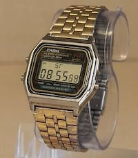 square silver Casio digital watch with link bracelet null