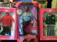 several Ken doll and suits boxes