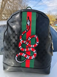 monogrammed black, red, and green Gucci leather backpack Bunker Hill, 25413
