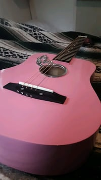 Pink child's  acoustic guitar