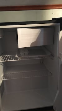 white and black personal refrigerator