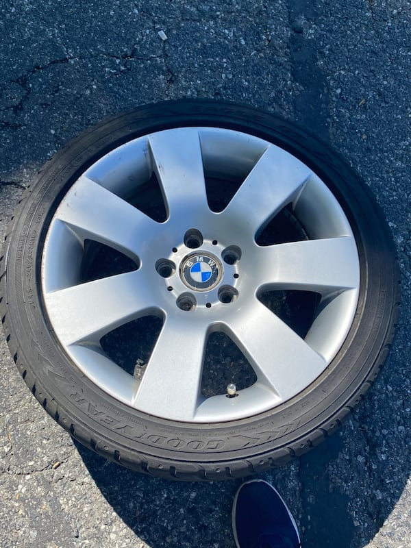 Spare BMW tire with rim 18 inches willing to sell or trade rim 17 af5f4fd2-0f2c-492b-b53b-0ef3cbd8524c