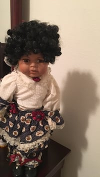 baby's white and blue dressed doll
