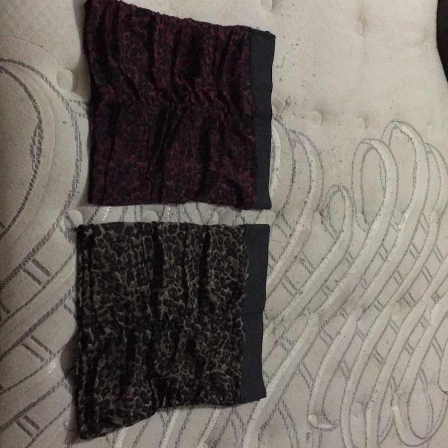 Photo Charlotte Russe Cheetah Print Skirts. One Black and Brown the other Black and Red. Size XS