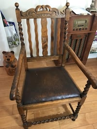 brown wooden framed black padded armchair 2268 mi