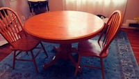 round brown wooden pedestal table Parkville, 21234
