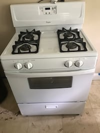 Used White And Black Whirlpool Four Burner Gas Range Oven