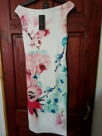 white, pink, and blue floral textile Manchester, M8 5AW