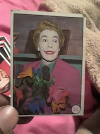 clown with pink peaked suit jacket holding petaled flower bouquet photo