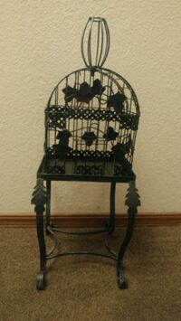 Vintage metal birdcage with stand