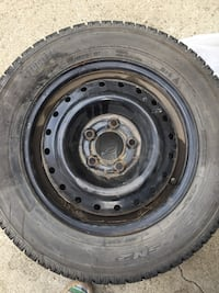 Black bullet hole car wheel with tire Edmonton, T6B 2K9