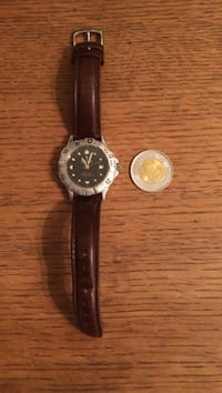 round silver analog watch with black leather strap Montréal, H2G 1Z1