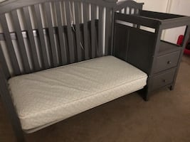 Baby bed with changing table and shelves