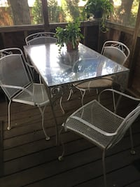 Iron oblong outdoor table and 4 chairs plexiglass top Walkersville, 21793